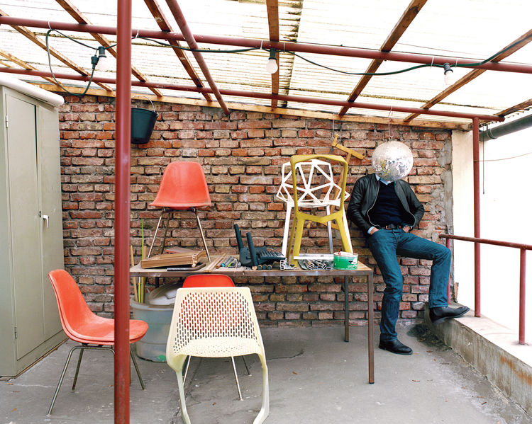"The ""terrace"", in his unassuming former factory space not far from the main train station in Munich, is a place where he and his cohorts can step outside for a breath of fresh air. A handful of classics as well as his own chairs—–like the Myto (foreground"