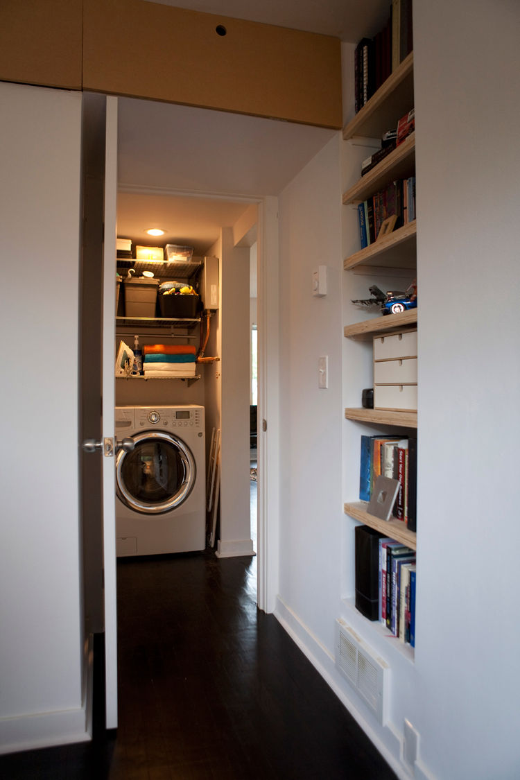 In just nine square feet, the linen closet down the hall holds a washer, dryer, on-demand hot water heater and shelves for storage.