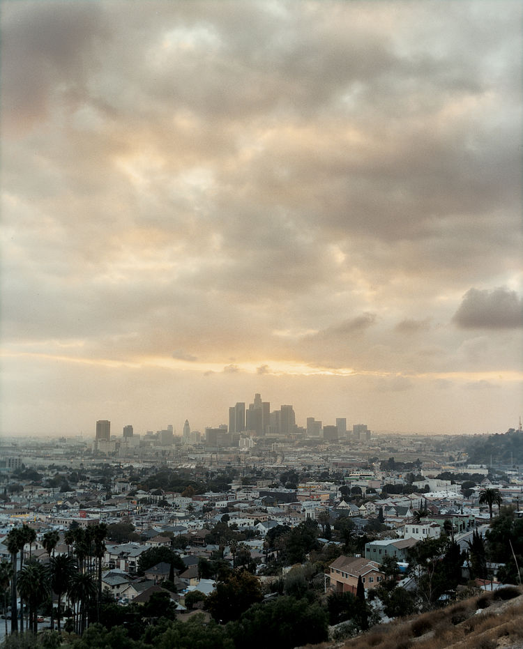 Covering more square miles than Rhode Island, greater Los Angeles is not always bathed in perfect sunshine. Here, the towers of downtown are lost in haze.