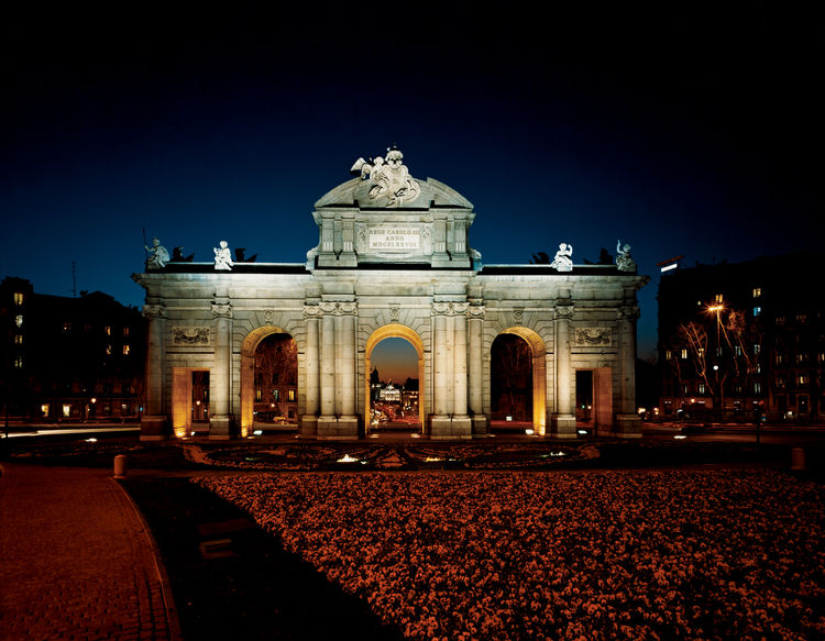 One of Madrid's most enduring architectural symbols, the Puerta de Alcalá was completed in 1778 to monitor the road to the nearby town Alcalá de Henares. Located in the Plaza de la Independencia, on what was once an active livestock route, the gate is mad
