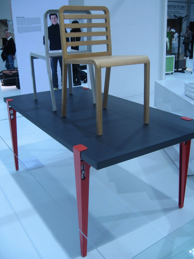 "This piece, by <a href=""http://www.dwell.com/articles/philippe-nigro-interview.html"">Philippe Nigro</a> for <a href=""http://www.ligne-roset-usa.com/Designers-And-Designs/philippe-nigro_221.aspx"">Ligne Roset</a>, is called the Table Universelle. The adjust"