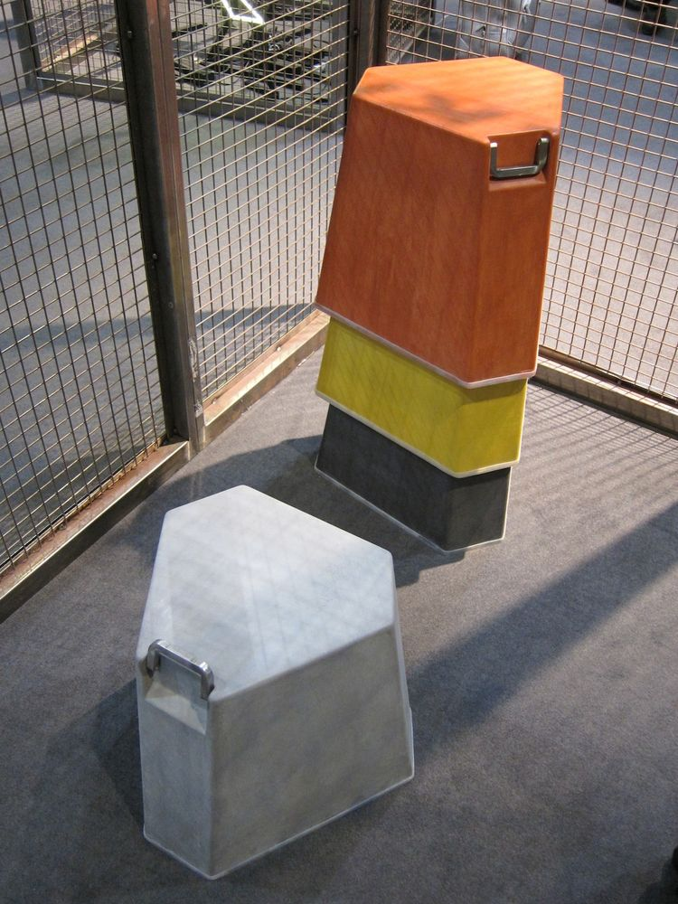 Also at Skitsch: these angular seats with built-in metal handles, great for outdoor or indoor use. They're made from a special lightweight concrete, so it's not unreasonable to tote them around.