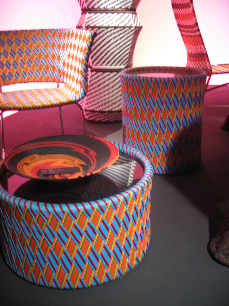 """Kente Table and Chairs by <a href=""""http://www.dwell.com/people/philippe-bestenheider.html?tab=about&c=y"""">Philippe Bestenheider</a> for <a href=""""http://www.varaschin.it/"""">Varaschin</a>. Though these items were introduced last year, I was really taken by ho"""