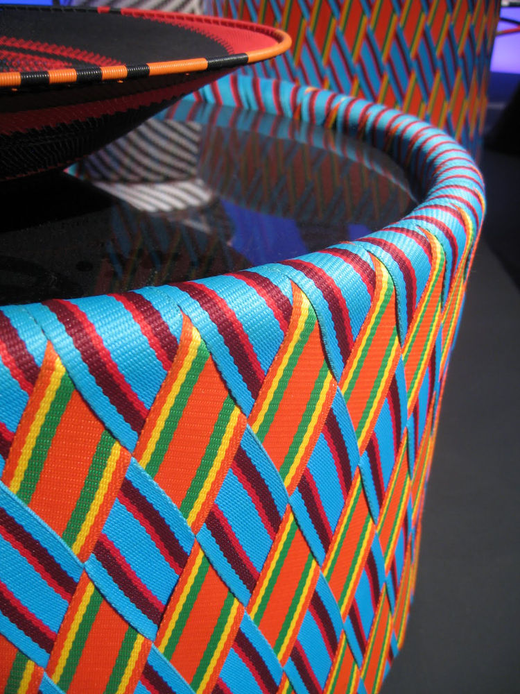 """A detail shot of the interwoven textile covering the Kente table, by Philippe Bestenheider for <a href=""""http://www.varaschin.it/"""">Varaschin</a>."""