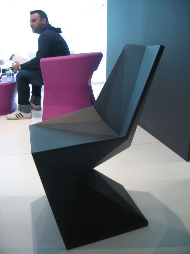 The Vertex chair, from Rashi's Outdoor Furniture Collection. It reminds me of a faceted Pantone chair. The hard edges and lines look uncomfortable, but the chair feels just the opposite.