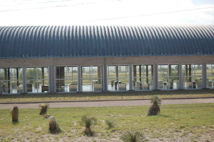 In 1986 Judd parted ways with DIA and the Chinati Foundation was born. Here we see one of two artillery sheds that Judd rehabbed with a new Quonset-style roof and new quartered windows—additions that doubled the proportions of both structures and provided