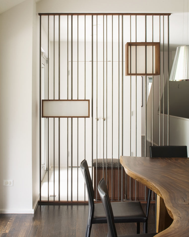 """One of our favorite MAKE-made details in the Hufft catalog is this screen in the """"Modern with a Side of Ranch"""" house. Made of walnut plywood, steel rods and 3form, the the shape and materials are echoed later in the dining room credenza."""