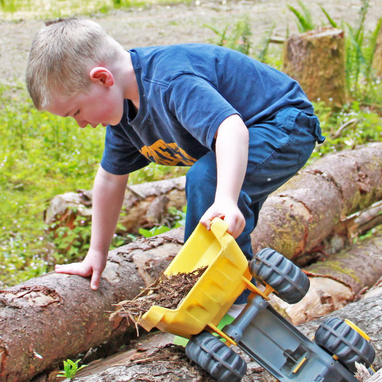 Charlie, our youngest sets up his own construction site on the property and transfers some wood chips with the help of his truck. He's practically grown up on the property and the transition to his future playground has been seamless.