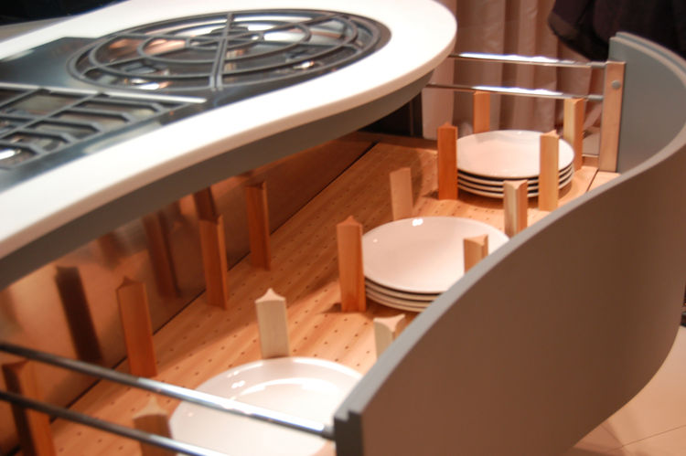 With no visible handles (a common feature found amongst nearly all the kitchen systems we saw at Eurocucina), Integra's drawers glide open to reveal stable storage of plates and utensils.