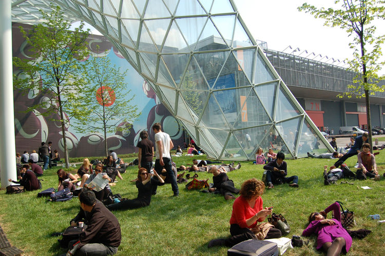 Outside of Eurocucina, Salone attendees take a grassy respite from the day's acres and acres of high-design delights.