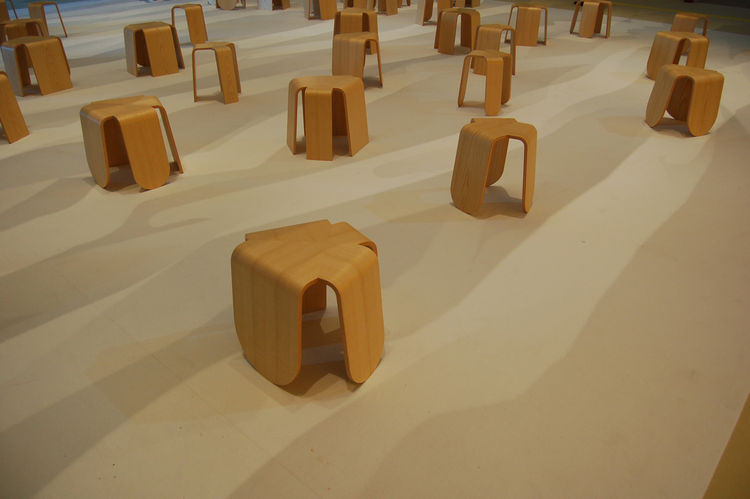 "Another public installation, this one created by Japanese design firm <a href=http://tonerico-inc.com/"">Tonerico:Inc</a>, featured a sea of 49 bentwood stools, each representing a different country of Asia. The shadows on the floor were cast by huge panel"