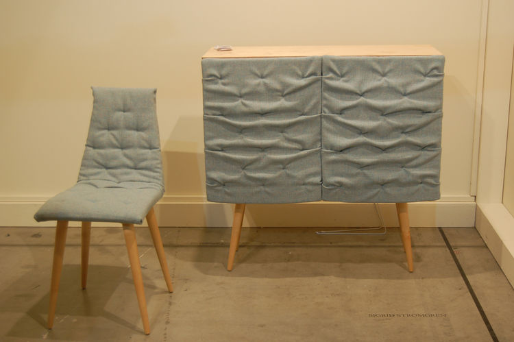 "The Eskimo Cabinet and Chair, by Swedish designer <a href=http://www.sigridstromgren.se/""> Sigrid Strömgren</a>. The bunched fabric covering the cabinet ""doors"" peels back to reveal shelving and is heavily padded in order to muffle sound."