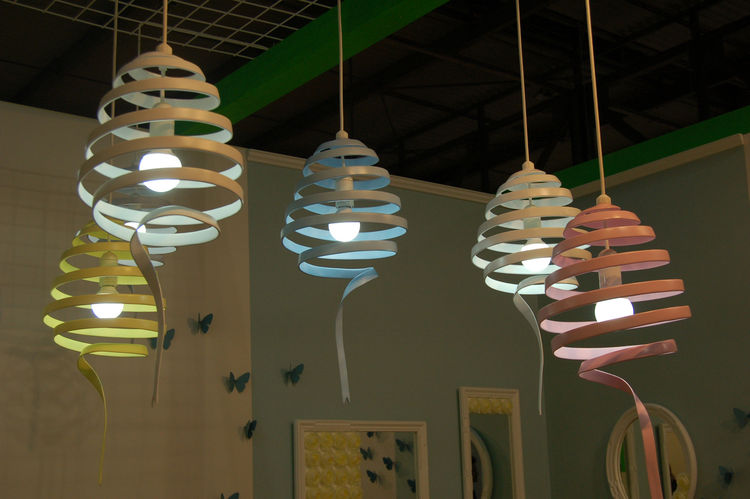 "I loved the sweet pastel hues of Swing, a bent-metal fixture by Japanese designer Atsushi Fujii of <a href=http://www.monochro.jp"">Monochro Design Studio</a>. She, along with her partner Momoko Naito, presented work at Salone Satellite for the very first"