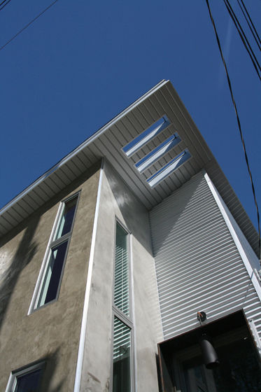 "Reeves incorporated a sort of architectural refrain in the openings at the roof's apex, which create interesting shadows on the exterior. Photo courtesy <a href=""http://www.linebox.ca/"">Linebox Studio</a>."