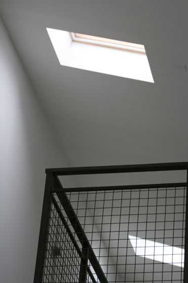 "Skylights punctuate the ceiling above the loft, bringing in more indirect light. Photo courtesy <a href=""http://www.linebox.ca/"">Linebox Studio</a>."