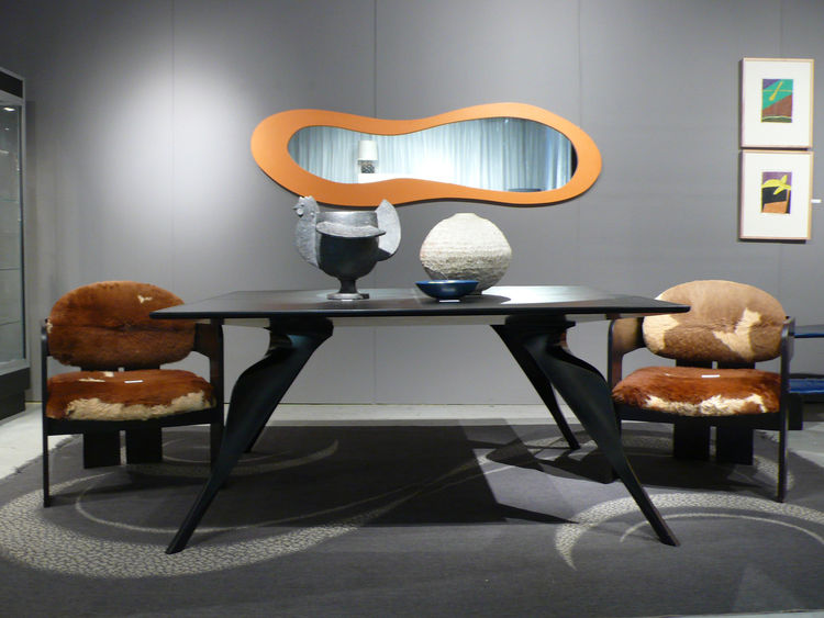 "The focal point at Dallas-based Sally Rosen <a href=""http://www.20thcenturycollections.com/"">20th Century Collections</a> was a leather-topped Alessandro Mendini/Zanotta ""Macaone"" table from 1985, 1969 Tobia Scarpa cowhide chairs, ceramics by Francois-Xav"