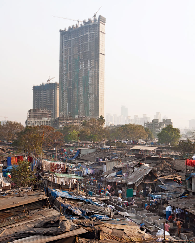 The jaw-dropping enormity of Mumbai's slums—–home to nearly 55 percent of the city's population—–starkly juxtaposes with the emergence of new wealth and booming construction.