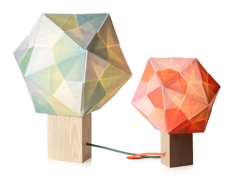 This attractive lamp features a paper shade based off of an origami tetrahedron. One trend in virtually all of the new lighting designs is wrapping the cord in colored material—a detail I consistently loved, though it's not the newest trick in the book.
