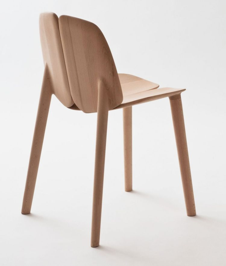 "A view of the completed chair, sculpted out of oak, maple, or ash using solar-powered, digitally controlled equipment. ""Chairs have the same properties they had hundreds of years ago, but technologies have lives and deaths,"" Erwan reflected. ""Resetting te"
