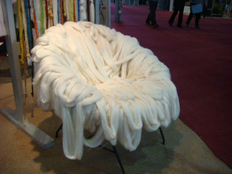 Combed cotton fibers are draped over a chair. Very Campana Brothers-esque.