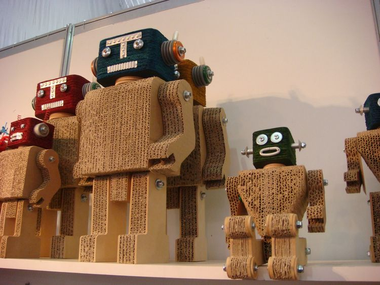 "Also from <a href=""http://geldres.com/"">Geldres Design</a>: a series of robots carved from cardboard sandwiched together."