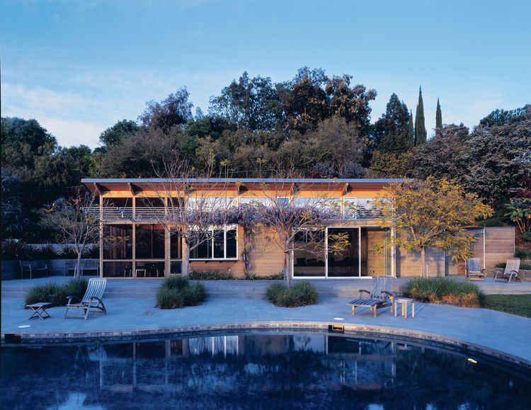 "A study in contrasts with the stolid stucco main house, this 750-square-foot pool house seems to float lackadaisically on the bluestone terrace. ""The pool house speaks of summer,"" says designer E. B. Min.<br /><br /><strong>Project:</strong> Burt Pool Hou"