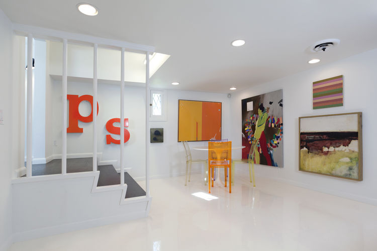 """The new media room, in which Popp retained the original tiny window as a nod to its 1940s character. Susan found the initials in a local shop, and daughter Olivia preferred them to be switched to say """"ps,"""" to stand for """"postscript."""" Surrounding the Saarin"""