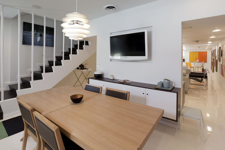 """A view from the dining area into the media room, which doubles as a gallery space. Photo by <a href=""""http://mikegraffigna.com/"""">Mike Graffigna</a>"""