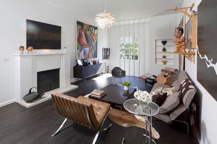 """The living room, reached by the main staircase off the entrance. The Mies chair is the first piece of modern furniture Popp purchased, on layaway. """"It took me two years to pay it off,"""" he says. Around the coffee table from B&B Italia are an Eames rocker a"""