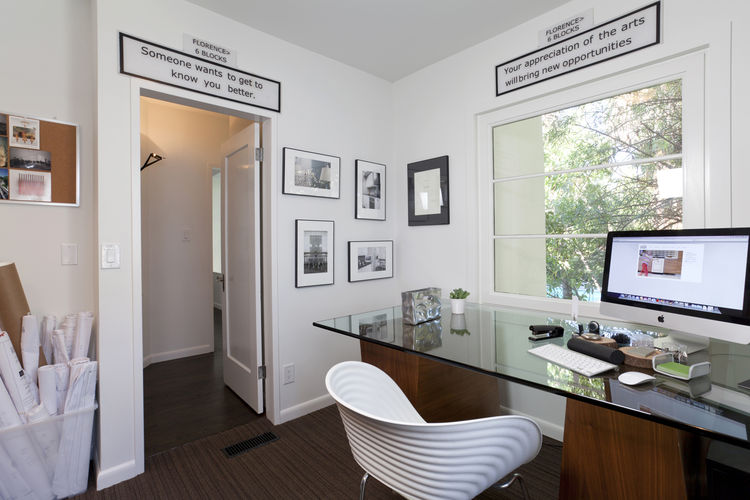 """Like in the media room, pieces by local artists hang in the office. Photo by <a href=""""http://mikegraffigna.com/"""">Mike Graffigna</a>"""