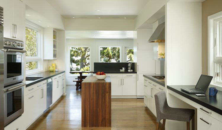 The new kitchen has stone counters; a walnut butcher-block island; corkboard for family projects and light on 4 sides.