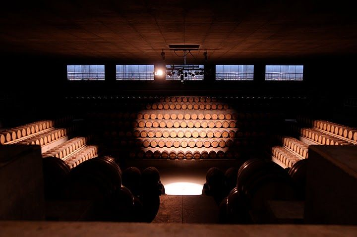 "A collection of 2,500 barrels are inside the ""Barriquerie"", each holding wine that will age for up to 20 months. Piano calls this space the winery's ""secret soul."" At center in the ceiling is the skylight that directs a central beam to the middle of the f"