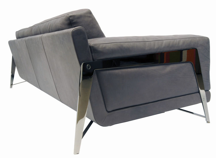 The metal legs of the Axiome Sofa pay subtle homage to Jean Prouvé. Designed by M. Tapinassi and M. Manzoni, 2009.
