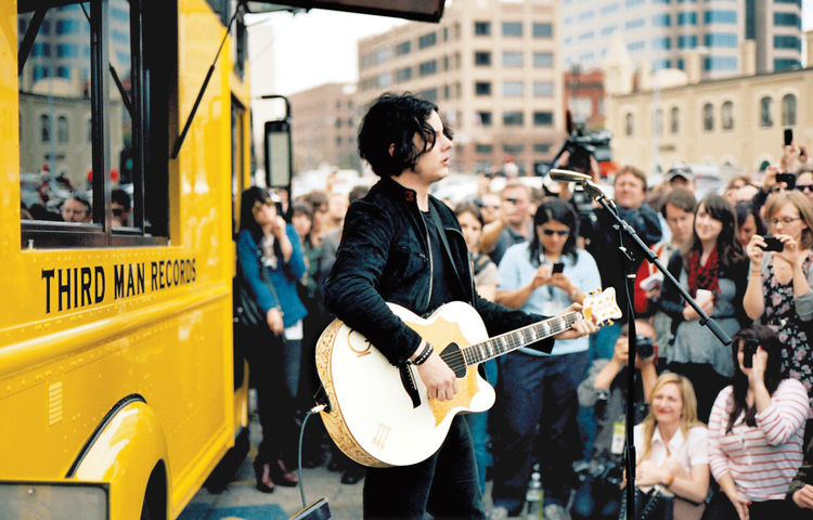 Jack White playing outside of Rolling Records.