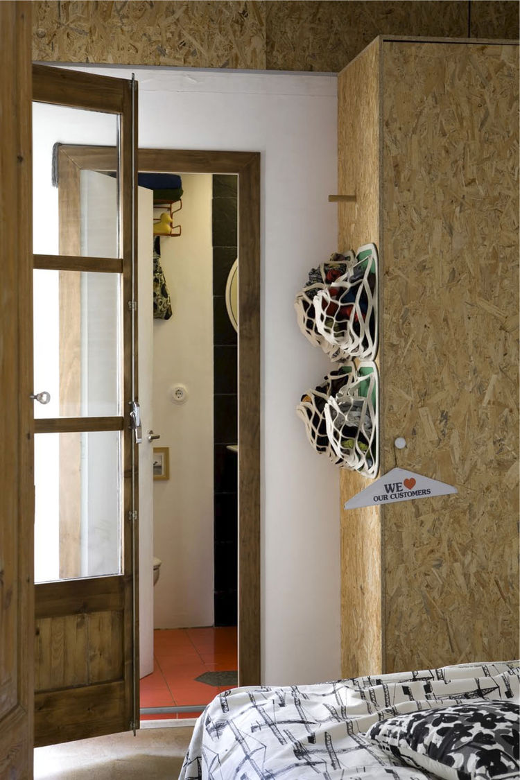 StuffBumps, the eco-friendly pop-up storage system that Scholtus designed with Graham Hill of the sustainability resource TreeHugger, hang on one side of a wardrobe constructed of oriented strand board (OSB), chosen because it contains minimal amounts of