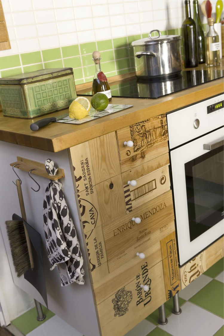"""""""I'm not usually a big fan of 'visible' recycling,"""" notes Scholtus, """"but I love the way the recycled wine boxes look and feel in contrast to the bright and shiny grass-green-and-white tiles."""""""