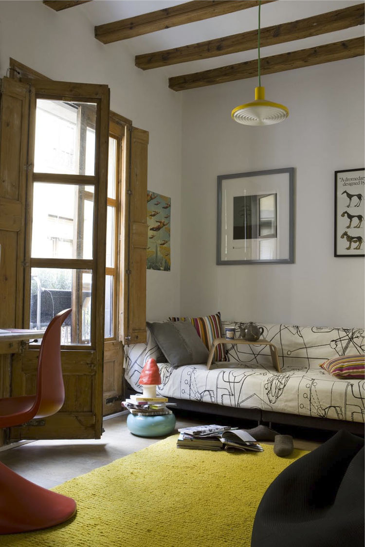 Wishing to avoid using harsh chemicals, the couple had the 18th-century beams and French doors in the living room and elsewhere sandblasted to rid them of woodlice. The rug, by Nani Marquina, is renewable and biodegradable as well as ethically produced.
