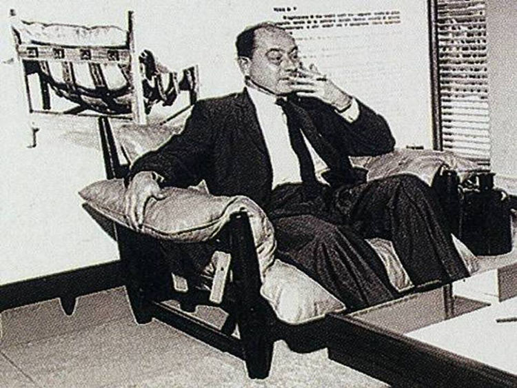 "George Nelson in a Rodrigues armchair, Rio, 1965. Photo courtesy <a href=""http://espasso.com/"">Espasso</a>."