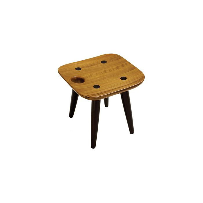 "Rodrigues designed the tauari-wood Sonia stool in 1997; its cutout reminiscent of a similar motif in his iconic 1954 Mocho stool. Photo courtesy <a href=""http://www.espasso.com"">Espasso</a>."