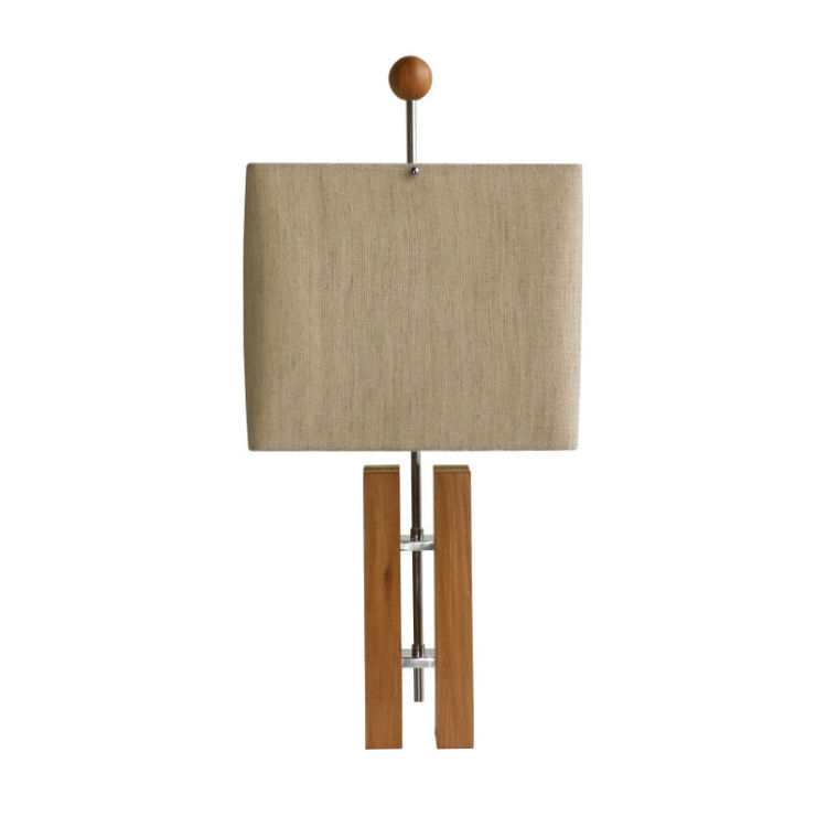 "A circa 1965 design, the Tcheco table lamp is made from peroba do campo wood and chrome steel with a hemp lampshade and produced by Mendes-Hirth in Brazil. Photo courtesy <a href=""http://www.espasso.com"">Espasso</a>."