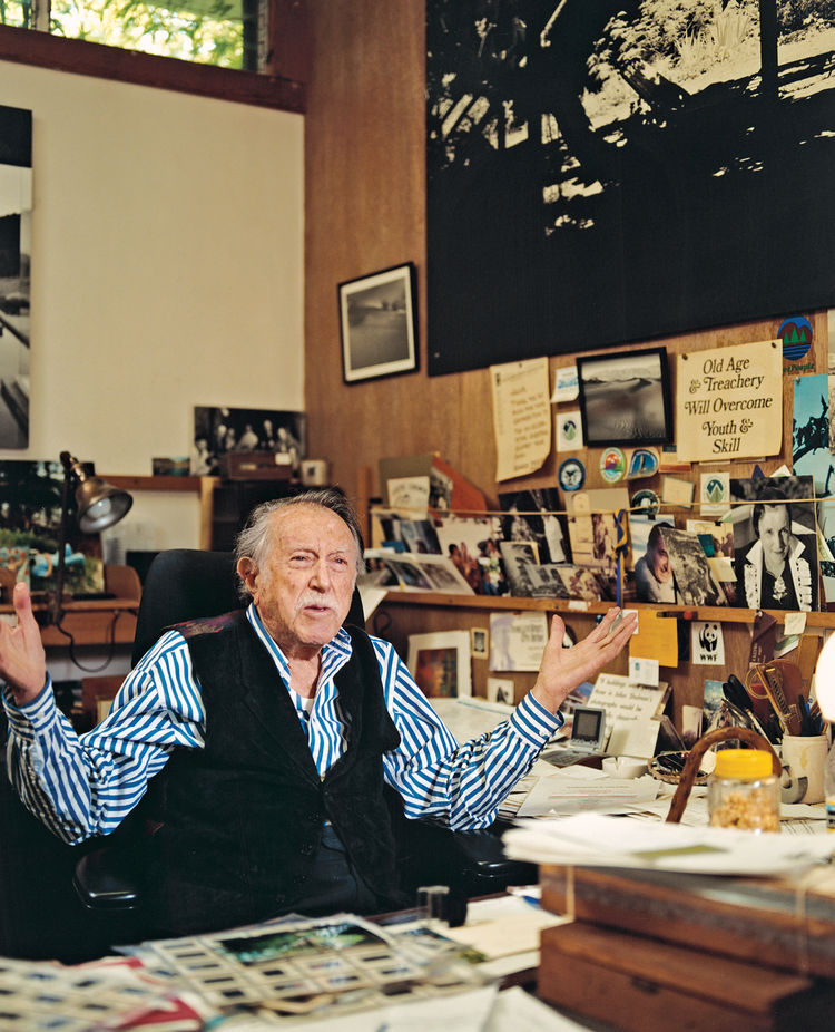 """A wonderful mess"" is how Shulman describes his desk. Interspersed among the family snapshots, mementos, and tchotchkes are several enlarged quotations, including one from Art News: ""If buildings were people, those in Julius Shulman's photographs would be"