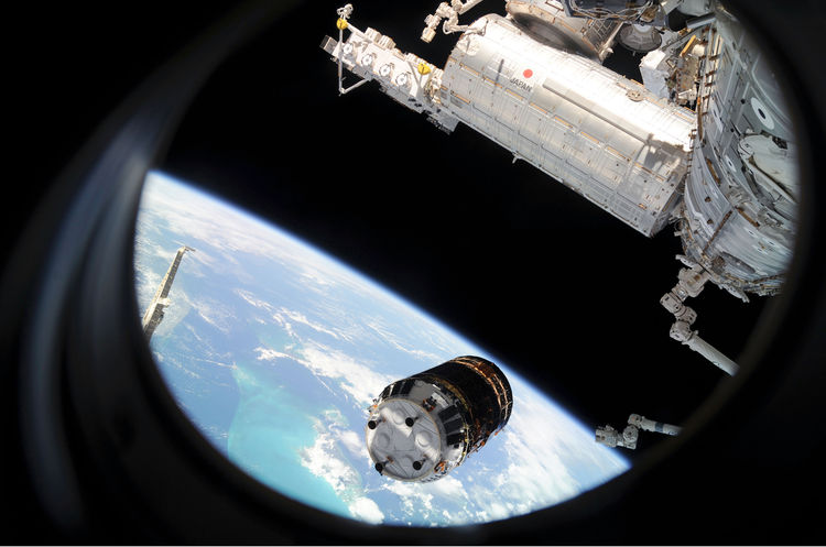 Backdropped by Earth's horizon and the blackness of space, the unpiloted Japanese H-II Transfer Vehicle (HTV) approaches the ISS. Once the HTV was in range, NASA astronaut Nicole Stott, Canadian Space Agency astronaut Robert Thirsk and European Space Agen