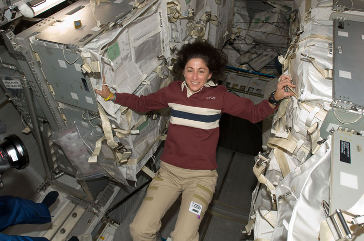 NASA astronaut Nicole Stott, Expedition 20 flight engineer, is pictured in the Leonardo Multi-Purpose Logistics Module (MPLM), temporarily attached to the ISS while Space Shuttle Discovery (STS-128) remains docked with the station. Photo taken September 5