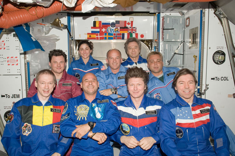 Crew members on the ISS pose for a group photo following a joint crew news conference in the Harmony node of the International Space Station. Pictured from the left (front row) are European Space Agency astronaut Frank De Winne, Expedition 20 flight engin