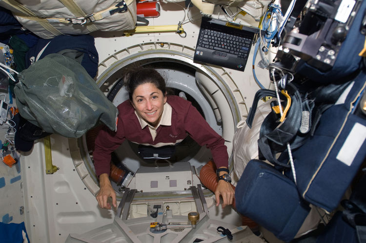 Astronaut Nicole Stott, STS-128 mission specialist, floats through a hatch on the Space Shuttle Discovery during flight day three activities. Photo taken August 30, 2009. <br /><br />Courtesy of NASA