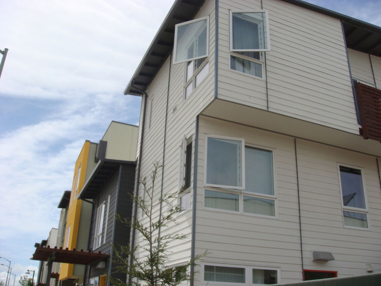 Budget materials, like the Hardie Board siding seen here, helped keep construction costs down and adds visual interest to the exteriors of the townhouses.