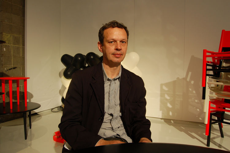 Designer Tom Dixon poses in his booth at the 2010 International Contemporary Furniture Fair.