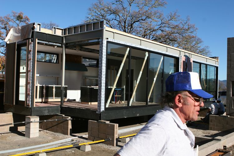"""After the kitchen modules are set in place, the diagonal bracing used during the transportation remains. """"The guy in the foreground worked for Marmol Radziner and had set pre-fabricated buildings all over the world during his career,"""" says Bill. """"He was q"""