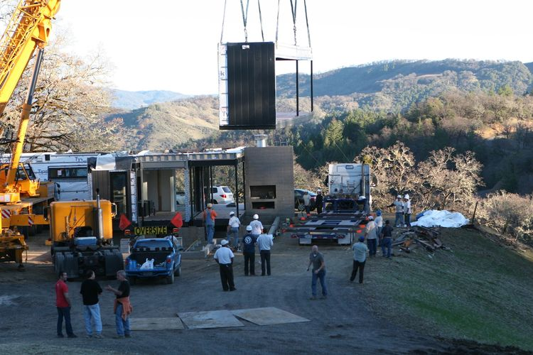 Another outdoor covered deck module being lowered into place.