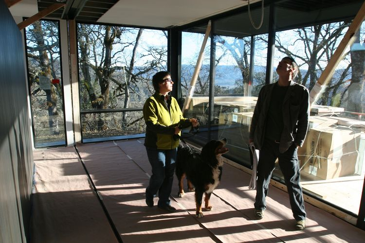 """Abbie, Stella (the Burton's other dog), and Riley, the project architect for Marmol Radziner, stand in the master bedroom, just after the last module was set.""""You can see the open drywall seam in the ceiling that will be closed up over the next six weeks"""
